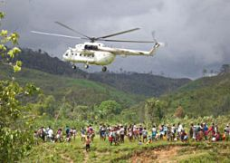 A helicopter brings relief supplies to the inhabitants of a village in Madagascar